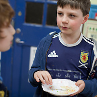 Picture Shows : Scott Ewing (age 9, p5).Muthill Primary School, Muthill by Crieff, Perthshire, Scotland stage an evening of international cooking to celebrate their joint work with a partner school Juliet Johnson School, Ghana which is visiting this week. They have strong links with the Ghanians and have helped to raise money to contribute toward funding a new school bus.   Feature for TESS..Picture Drew Farrell Tel : 07721-735041