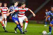 Blackpool midfielder Matty Virtue (17) tackles Doncaster Rovers midfielder Ben Sheaf (6) during the EFL Sky Bet League 1 match between Doncaster Rovers and Blackpool at the Keepmoat Stadium, Doncaster, England on 17 September 2019.