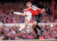 Fredrik Ljungberg (Arsenal) challenges Manchester City goalkeeper Nicky Weaver. Arsenal v Manchester City, F.A.Carling Premiership, 28/10/2000. Credit Colorsport / Stuart MacFarlane.