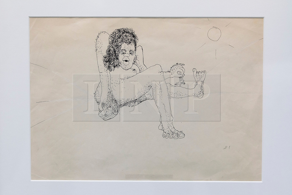 """© Licensed to London News Pictures. 21/03/2014. London, UK. 'Untitled illustration of a hairy woman holding a miniature man by the arm' (GB£12,000-15,000) by the late Beetles singer John Lennon, allegedly the piece that brought him to the attention of his future wife Yoko Ono, is seen during the press view for a new sale at Sotheby's auction house in London today (21/03/2014). The auction, entitled """"You Might Well Arsk"""", features original drawings and manuscripts by the singer from 1964-1965. Photo credit: Matt Cetti-Roberts/LNP"""