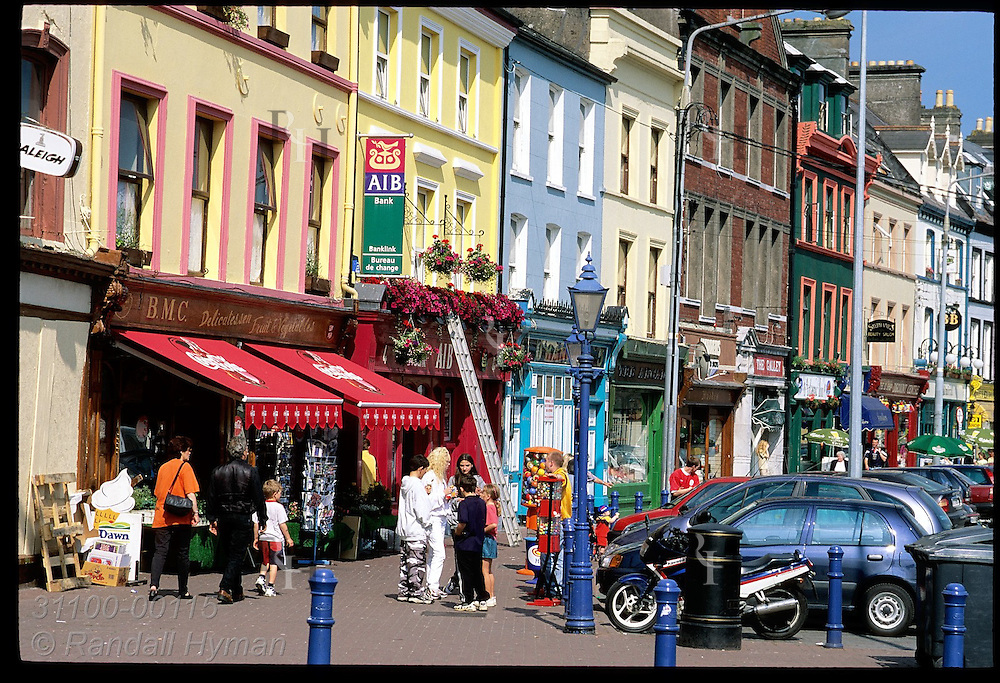 Colorful Victorian bldgs line main street along seafront in town of Cobh, County Cork. Ireland