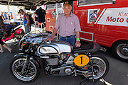 3 times World Champion, Hugh Anderson from New Zealand poses with his old race bike at the Cemetery Circuit Road Races, Wanganui, Boxing Day which was the 3rd and final round of the 2014 Suzuki Series