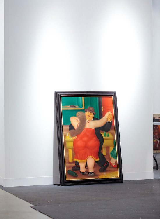 Botero painting awaiting to be hung at Art Basel Miami Beach 2011
