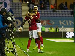 Famara Diedhiou of Bristol City (L) celebrates after scoring his sides second goal - Mandatory by-line: Jack Phillips/JMP - 11/01/2020 - FOOTBALL - DW Stadium - Wigan, England - Wigan Athletic v Bristol City - English Football League Championship