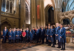 "© Licensed to London News Pictures. 10/11/2018. Bristol, UK. The Royal British Legion Festival of Remembrance 1918-2018 at Bristol Cathedral. The Kizzy Morrell Studio 7 choir and pupils from Badminton School perform ""Something inside so Strong"" written by Labi Siffre. On the eve of the Centenary of the end of the First World War the Royal British Legion holds a special Festival of Remembrance in Bristol Cathedral, bringing together musical talent from across the region presenting a poignant tribute from a variety of local performers. The second part of the evening will crescendo with a performance of Karl Jenkins' The Peacemakers by the 120 Members of Lucis and Noctis Choirs and the Southern Sinfonia Orchestra directed by Francis Faux. The piece is dedicated to all those who have lost their lives during armed conflict. During WW1 Soldiers from all over the World from numerous Continents, Commonwealth Countries and Nations Worldwide of all faiths castes creeds and religions served fought and died for Britain. The British Empire's colonies sent over two and a half million men to fight for Britain during the war, and 400,000 Muslims fought for Great Britain. The Lord Mayor Cleo Lake with Kizzy Morell represents the 60,000 Black South Africans, 15,600 Caribbean and 120,000 Africans who fought in WW1.<br /> Babbi Channa represents the 100,000 Sikhs, One million Indians who fought in WW1<br /> Chinese lady; Represents 140,000 Chinese Labour Corps Members<br /> Muslim lady; Representing the 400,000 Muslims who fought in WW1<br /> Nepalese lady; Representing the 90,000 Ghurkhas who fought in WW1<br /> (Last three representatives pupils from Badminton School )<br /> Photo credit: Simon Chapman/LNP"