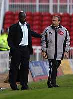 Photo: Alan Crowhurst.<br />Swindon Town v Boston Utd. The FA Cup. 05/11/2005. Swindon manager Iffy Onuora (L) isn't interested in the fourth official.