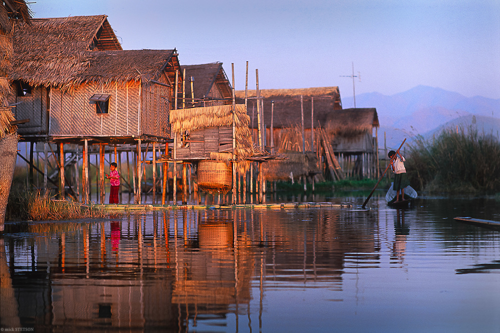 — Stilt houses and floating fields line the waterways of Ywama village on Inle Lake. The Intha people grow everything from vegetables to flowers on these fiellds.