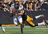 September 29 2012: Minnesota Golden Gophers wide receiver Derrick Engel (18) is hit from behind by Iowa Hawkeyes linebacker James Morris (44) during the first quarter of the NCAA football game between the Minnesota Golden Gophers and the Iowa Hawkeyes at Kinnick Stadium in Iowa City, Iowa on Saturday September 29, 2012. Iowa defeated Minnesota 31-13 to claim the Floyd of Rosedale Trophy.