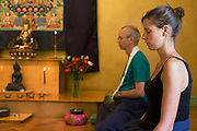 Buddhists meditate in silence for 30 minutes in their Shrine Room at the Rivendell Buddhist Retreat Centre, England. ..Reproduced for Alain de Botton's 'Religion for Atheists' 2010. .Photograph copyright Richard Baker, London.richard@bakerpictures.com.Tel 0044 207836 287080.