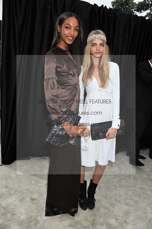 Left to right, JOURDAN DUNN and CARA DELEVINGNE at the annual Serpentine Gallery Summer Party sponsored by Burberry held at the Serpentine Gallery, Kensington Gardens, London on 28th June 2011.