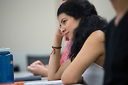 Sabrina Villanueva listens during her Spanish class at the University of Rochester in Rochester, New York on August 31, 2016. Villanueva earned 12 credits through a community college while in high school in Dallas, but the University didn't accept them, causing her to pursue a minor in Spanish rather than sociology or psychology as she had originally intended.