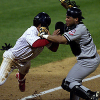 (SPORTS) Lakewood 4/27/2001 The Lakewood Blue Claws #13 Rob Avila collides with the Greensboro Bats catcher # 45 Omar Fuentes as he places the tag on him at home plate during the bottom of the 4th inning . He was out on the play..  Michael J. Treola Staff Photographer.........MJT