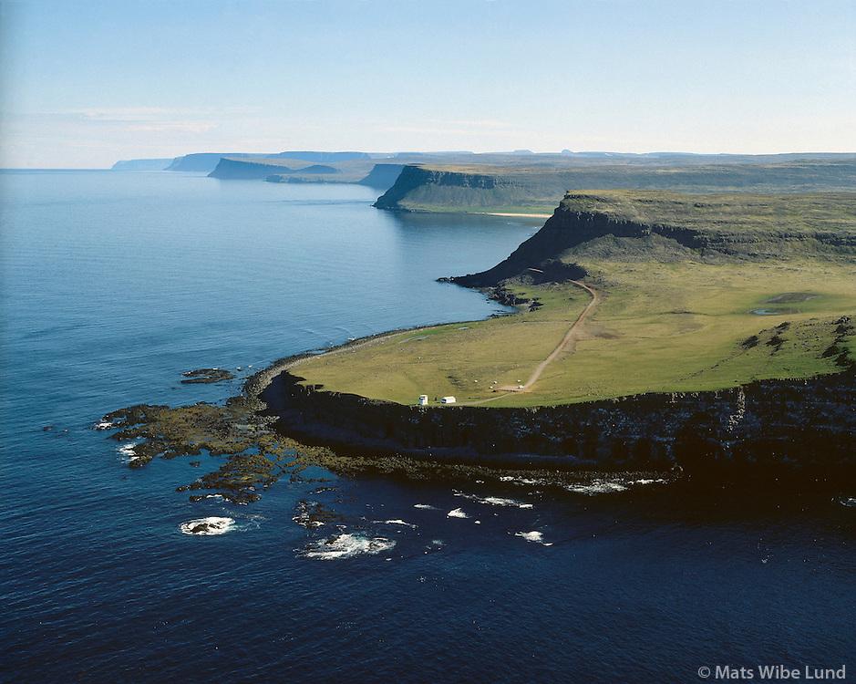 Látrabjarg, Bjargtangar séð til norðurs, Vesturbyggð áður Rauðasandshreppur, Loftmynd.Latrabjarg lighthouse, Bjargtangar the westernmost part of Europe.  Vesturbyggd former Raudasandshreppur. Aerial