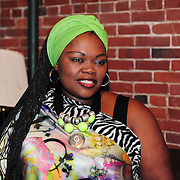 A member of the Soweto Gospel Choir in the Green Room backstage before their performance at The Music Hall in Portsmouth, NH
