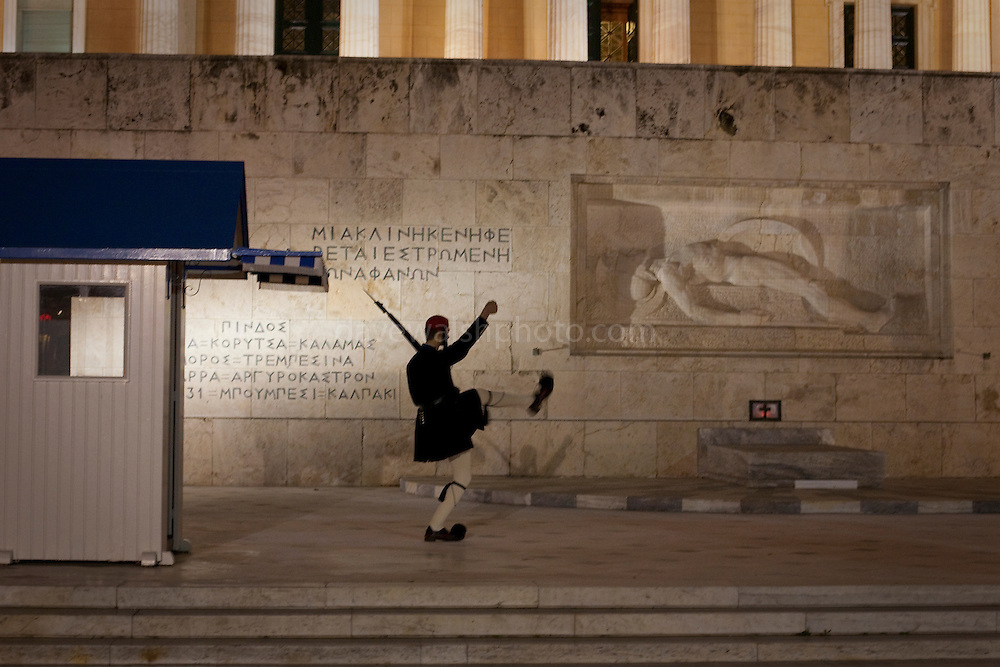 Greek soldiers of the Evzones carry out the changing of the guard at the Hellenic Parliament building, the presidential palace of Greece and the Tomb of the Unknown Solider in Syntagma Square.