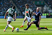 Graham Carey (10) of Plymouth Argyle is tackled by Matt Clarke (5) of Portsmouth during the EFL Sky Bet League 1 match between Plymouth Argyle and Portsmouth at Home Park, Plymouth, England on 14 April 2018. Picture by Graham Hunt.
