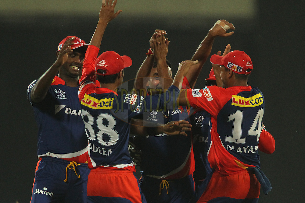 Shahbaz Nadeem of the Delhi Daredevils and Amit Mishra of the Delhi Daredevils are congratulated for getting Kieron Pollard of Mumbai Indians wicket during match 21 of the Pepsi IPL 2015 (Indian Premier League) between The Delhi Daredevils and The Mumbai Indians held at the Ferozeshah Kotla stadium in Delhi, India on the 23rd April 2015.<br /> <br /> Photo by:  Shaun Roy / SPORTZPICS / IPL