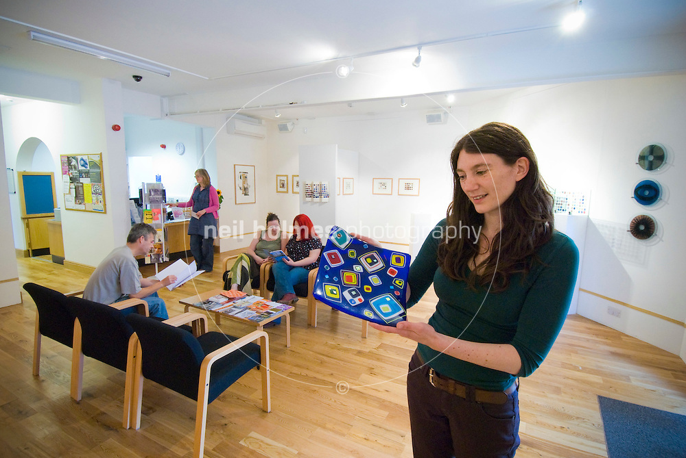 Sarah Pennington, art development worker at Artlink centre for community arts, on Princes Avenue, Hull. Sarah is holding a pice of pottery on sale in the gallery created by a local artist.