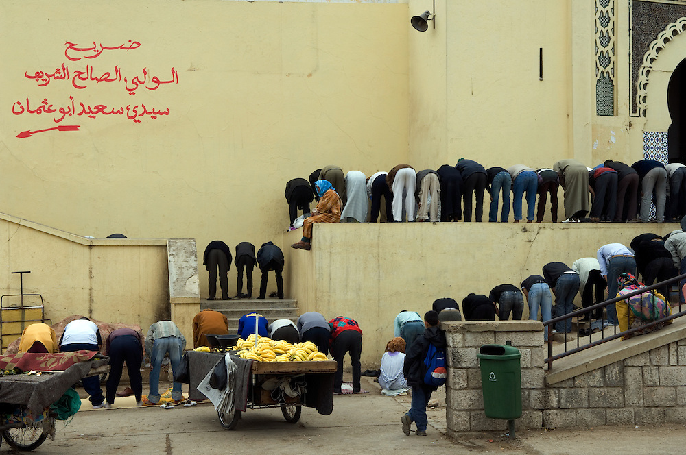 MOROCCO; Meknes. .Friday prayers spill out of the mosque and into the streets of Meknes