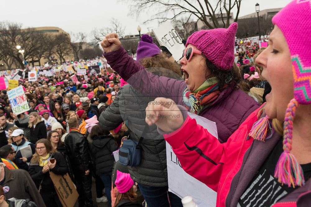 Demonstrators wave signs and shout slogans during the Women's March on Washington in protest to President Donald Trump January 21, 2017 in Washington, DC. More than 500,000 people crammed the National Mall in a peaceful and festival rally in a rebuke of the new president.