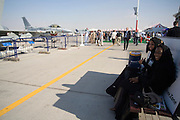 Dubai 2005, 9th International Aerospace Exhibition. U.A.E. Air Force F16, ladies in black.