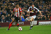 Sunderland defender Patrick van Aanholt (3) is chased down by Burnley midfielder George Boyd (21)  during the The FA Cup third round replay match between Burnley and Sunderland at Turf Moor, Burnley, England on 17 January 2017. Photo by Simon Davies.
