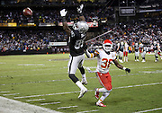 Oakland Raiders wide receiver James Jones (89) leaps as he tries to catch an overthrown pass while covered by Kansas City Chiefs strong safety Ron Parker (38) during the NFL week 12 regular season football game against the Kansas City Chiefs on Thursday, Nov. 20, 2014 in Oakland, Calif. The Raiders won their first game of the season 24-20. ©Paul Anthony Spinelli
