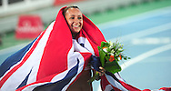 Great Britain's Jessica Ennis celebrates with national flag after the women's heptathlon 800m at the 2010 European Athletics Championships at the Olympic Stadium in Barcelona on July 31, 2010.