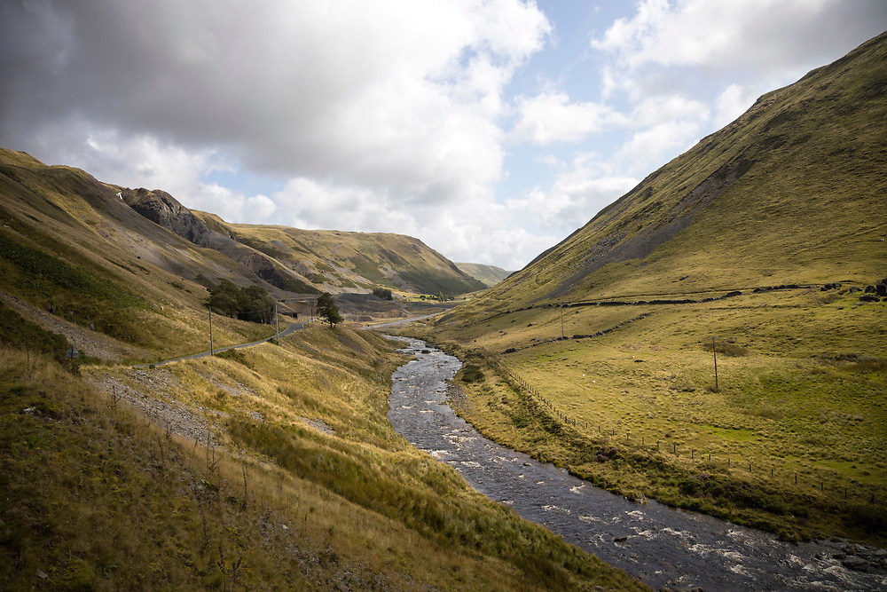 DEVILS BRIDGE, WALES, UK 17TH AUGUST 2019 - Rural mountain road and stream in valley between Rhayader and Devils Bridge, County of Ceredigion, Mid Wales, UK.