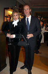 MIKE & ANGIE RUTHERFORD at a Christmas party to celebrate the 225th Anniversary of Asprey held at their store 167 New Bond Street, London on 7th December 2006.<br />