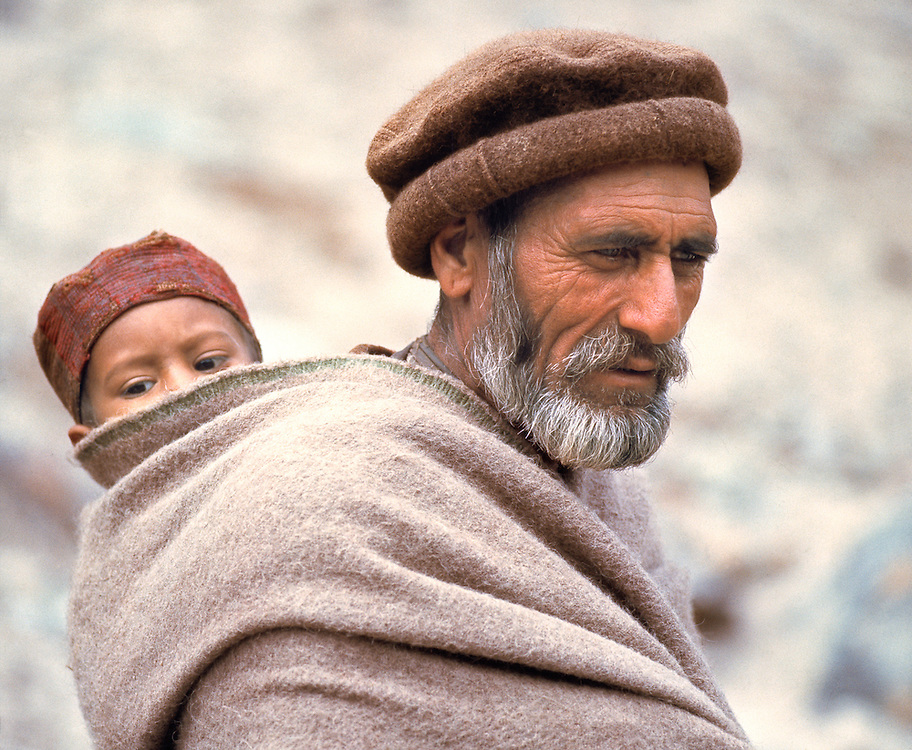 A father carries his son on his back in Chitral, Khyber Pakhtunkhwa, Pakistan.
