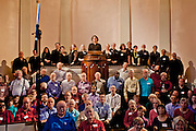 Massed choirs from Unitarian churches in the Washington D.C. region after a concert at All Souls Unitarian Church in March 2014.  Composer Jim Papoulis at the center of the group.