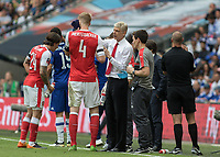 Football - 2017 FA Cup Final - Arsenal vs. Chelsea<br /> <br /> Arsenal Manager Arsene Wenger  gives instruction to Per Mertesacker at Wembley.<br /> <br /> COLORSPORT/DANIEL BEARHAM