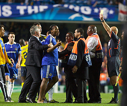 LONDON, ENGLAND - Wednesday, May 6, 2009: Chelsea's Didier Drogba is held back by manager Guus Hiddink as he attacks referee Tom Henning Ovrebo at the end of the UEFA Champions League Semi-Final 2nd Leg match at Stamford Bridge. (Photo by Carlo Baroncini/Propaganda)