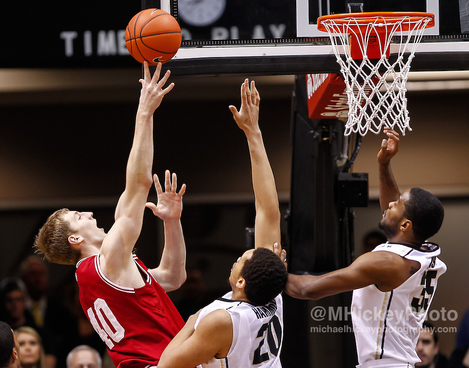 WEST LAFAYETTE, IN - JANUARY 30: Cody Zeller #40 of the Indiana Hoosiers shoots the ball over A.J. Hammons #20 of the Purdue Boilermakers and Rapheal Davis #35 of the Purdue Boilermakers at Mackey Arena on January 30, 2013 in West Lafayette, Indiana. (Photo by Michael Hickey/Getty Images) *** Local Caption *** Cody Zeller; A.J. Hammons; Rapheal Davis
