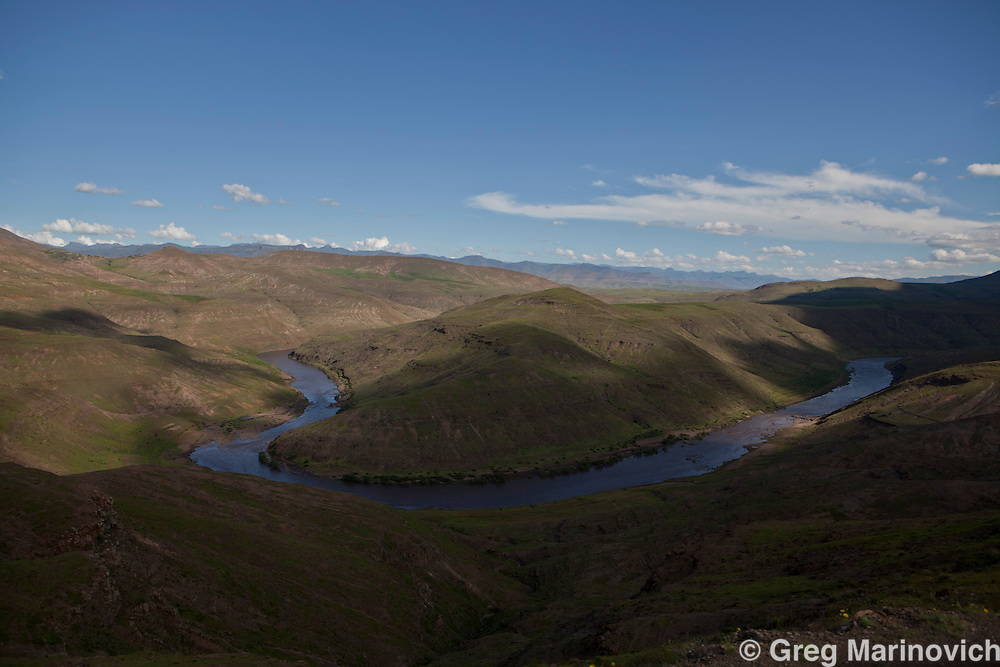 Thaba Tseka district, Lesotho, February 15, 2011: A view of the Senqu River, with Koma-Koma village at the river bend in the right hand side of picture. photo Greg Marinovich