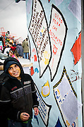 A child writes on one of the carnival floats
