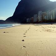 Foot prints in the sand, a beach scene at Sao Conrado beach, Rio de Janeiro,  Brazil. 7th July 2010. Photo Tim Clayton..