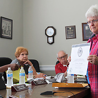Aberdeen Historic Preservation Commission Chairperson Kathy Seymour shows Mayor Maurice Howard, not pictured, a certificate from the U.S. Department of Archives and History and the National Park Service commemorating the city's 20-year participation in the certified local government program.