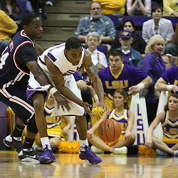 14 February 2009: LSU guard Marcus Thornton (5) scrambles for a loose ball with Terrico White (24) of Ole Miss during a 73-66 win by the LSU Tigers against SEC rival the Ole Miss Rebels at the Pete Maravich Assembly Center in Baton Rouge, LA.
