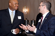 Maurice McDonald of the Dayton Development Coalition (left) talks with AT&T external affairs director Mark Romito during the Dayton Area Chamber of Commerce Government Affairs Breakfast at the Crowne Plaza Hotel in downtown Dayton, Wednesday, November 30, 2011.
