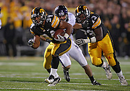 October 15, 2011: Iowa Hawkeyes running back Marcus Coker (34) on a run during the second half of the NCAA football game between the Northwestern Wildcats and the Iowa Hawkeyes at Kinnick Stadium in Iowa City, Iowa on Saturday, October 15, 2011. Iowa defeated Northwestern 41-31.