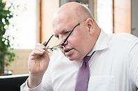 11 APR 2019, BERLIN/GERMANY:<br /> Peter Altmaier, CDU, Bundesminister fuer Wirtschaft und Energie, waehrend einem Interview, in seinem Buero, Bundesministerium fuer Wirtschaft und Energie<br /> IMAGE: 20190411-01-007<br /> KEYWORDS: Büro