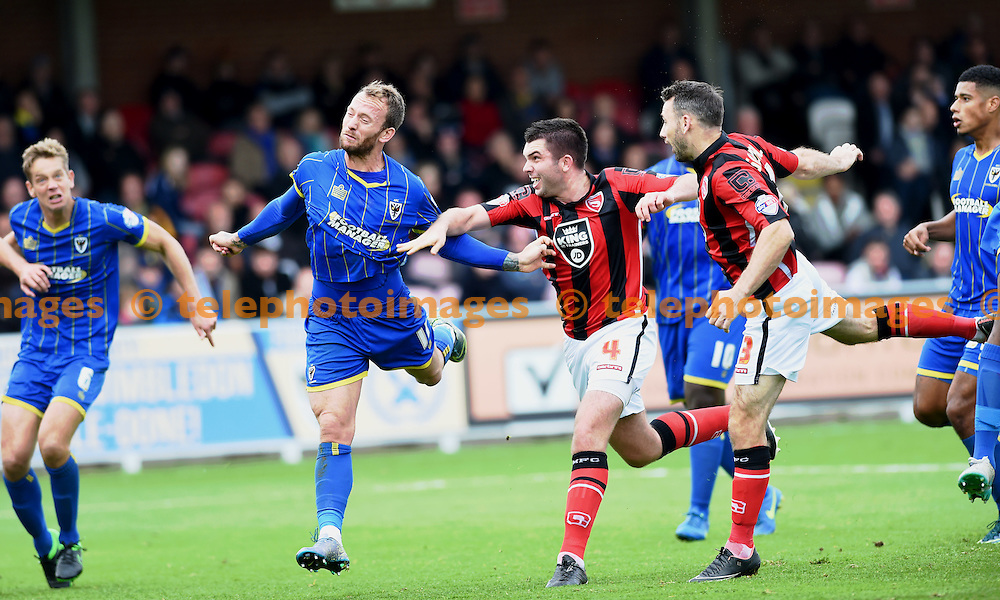 Alan Goodall of Morecambe (right) heads in their third goal in the first half during the Sky Bet League 2 match between AFC Wimbledon and Morecambe at the Cherry Red Records Stadium in Kingston. October 17, 2015.<br /> Simon  Dack / Telephoto Images<br /> +44 7967 642437