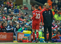 LIVERPOOL, ENGLAND - Sunday, December 13, 2015: Liverpool's manager Jürgen Klopp shakes hands with Adam Lallana after substituting him against West Bromwich Albion during the Premier League match at Anfield. (Pic by James Maloney/Propaganda)