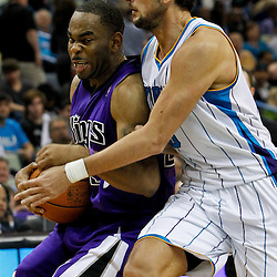 February 6, 2012; New Orleans, LA, USA; Sacramento Kings guard Marcus Thornton (23) is defended by New Orleans Hornets shooting guard Marco Belinelli (8) during the second half of a game at the New Orleans Arena. The Kings defeated the Hornets 100-92.  Mandatory Credit: Derick E. Hingle-US PRESSWIRE