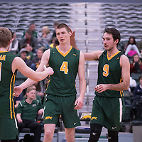 2nd year middle Cody Caldwell (4) of the Regina Cougars during the home game on January 6 at Centre for Kinesiology, Health and Sport. Credit: Arthur Ward/Arthur Images