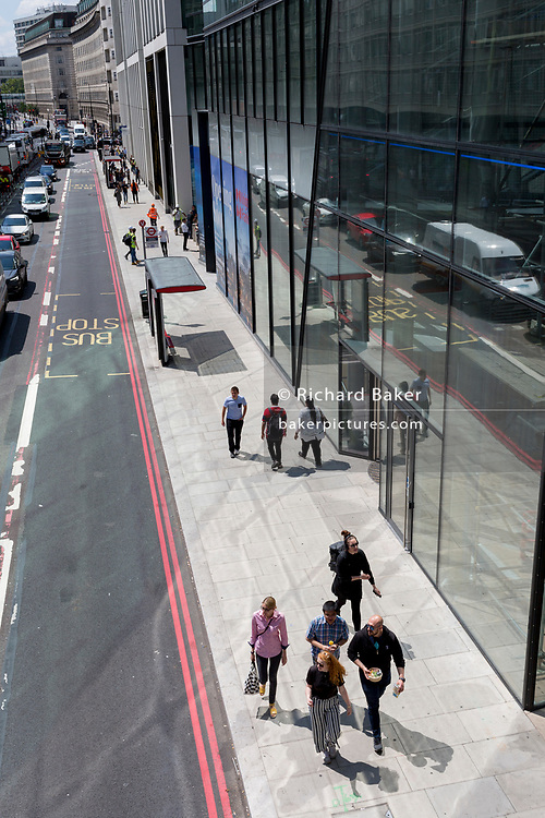 After extensive redevelopment of a new housing and retail complex, pedestrians walk along newly-laid pavements on York Road, SE1  on 16th July 2019, in London, England.