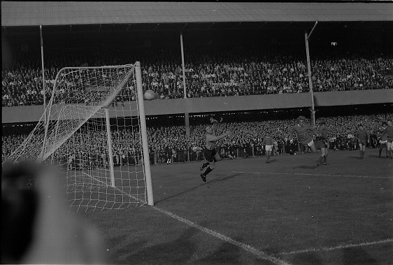 Waterford FC vs Manchester United at Lansdowne Road..1968..18.09.1968..09.18.1968..18th September 1968..Waterford FC as champions of the league of Ireland drew Manchester United, the European Champions,in the first round of this years competition.The Waterford team was as follows: Peter Thomas, Peter Bryan, Noel Griffin, Vinny Maguire, Jackie Morley, Jimmy McGeough, Al Casey, Alfie Hale, John O'Neill, Shamie Coad and Johnny Matthews. Manchester United won the tie 3 -1 with Denis Law being the man of the match..Alex Stepney,Tony Dunne,Francis Burns,Paddy Crerand,.Bill Foulkes,Nobby Stiles,George Best,Denis Law,.Bobby Charlton,David Sadler,Brian Kidd were the starting eleven for United..The players take the field for the European Cup match at Lansdowne Road...Image shows a diving header from Denis Law as he completes his hat trick.