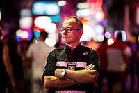 A portrait of Andrejos Plocins, a Pattaya resident and a volunteer in the Foreign Tourist Police force, standing on Walking Street in Pattaya, Thailand.
